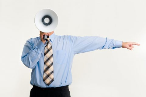man-with-megaphone-pointing-3851255